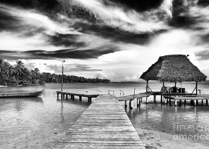Dock At Drago Greeting Card featuring the photograph Dock At Drago by John Rizzuto