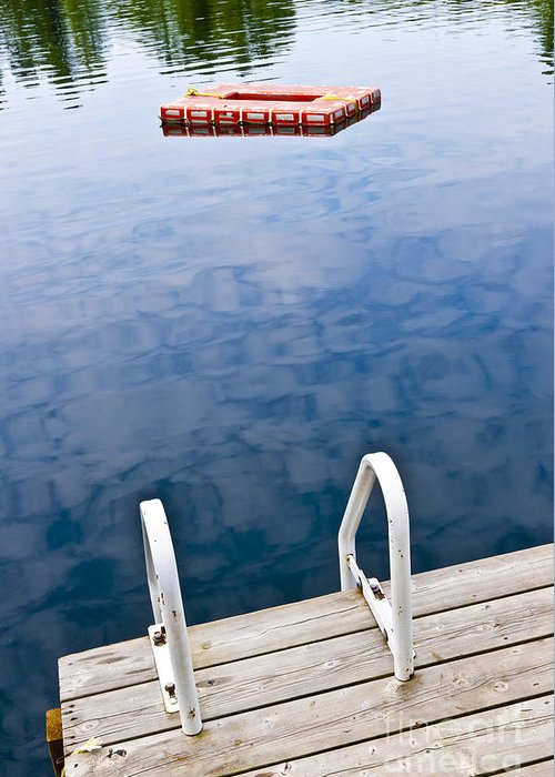Dock Greeting Card featuring the photograph Dock On Calm Lake In Cottage Country by Elena Elisseeva