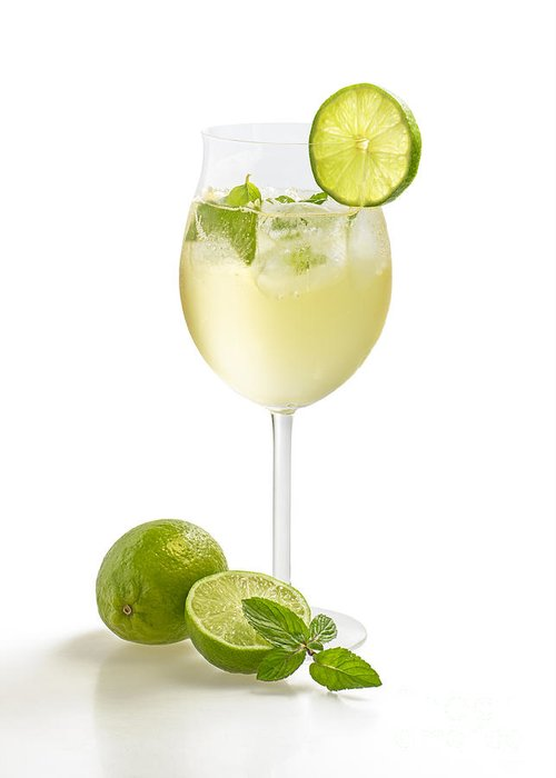 Champagne Greeting Card featuring the photograph Drink With Lime And Mint In A Wine Glass by Palatia Photo