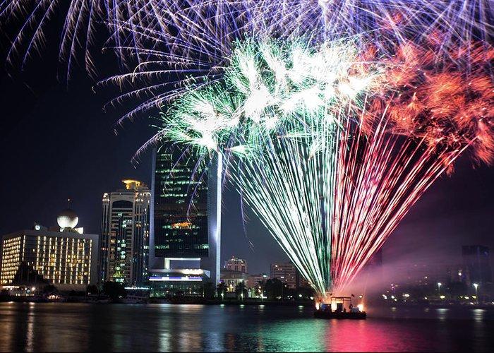 Firework Display Greeting Card featuring the photograph Dubai Creek Fireworks by Shahin Olakara Photography