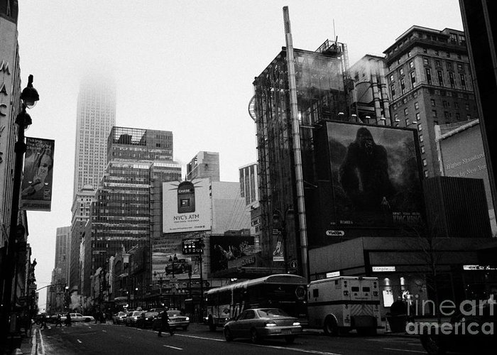 Usa Greeting Card featuring the photograph empire state building shrouded in mist from west 34th Street and 7th Avenue new york city usa by Joe Fox