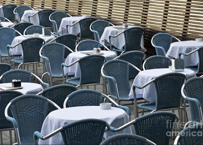 Blue Greeting Card featuring the photograph Empty Restaurant Seats And Tables by Sami Sarkis
