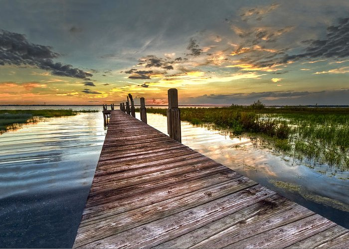Clouds Greeting Card featuring the photograph Evening Dock by Debra and Dave Vanderlaan
