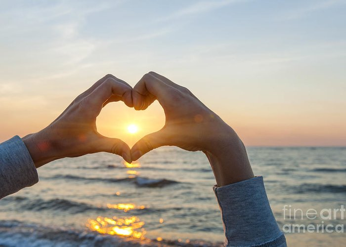 Heart Greeting Card featuring the photograph Fingers Heart Framing Ocean Sunset by Elena Elisseeva