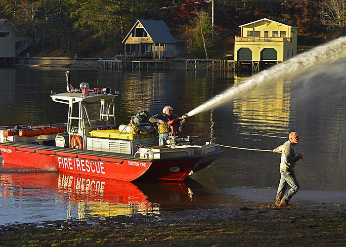Firemen; Fire; Fireboat; Men; Lake; Water; Shore; Burning; House; Danger; Job; Industry; Profession; Work; Workers; People; Men; Talking; Ready; Equipment; Pumper; Protection; Site; Place; Safe; Save; Fighting; Spraying Greeting Card featuring the photograph Fire Boat by Susan Leggett