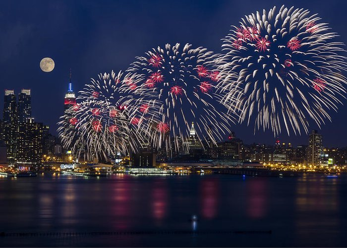 4th Of July Greeting Card featuring the photograph Fireworks And Full Moon Over New York City by Susan Candelario