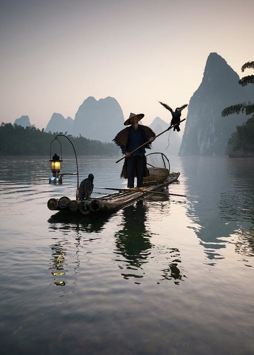 Chinese Culture Greeting Card featuring the photograph Fisherman With Cormorants On Li River by Matteo Colombo