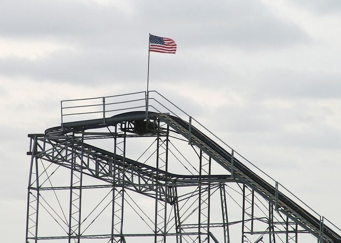 Seaside Heights Roller Coster Greeting Card featuring the photograph Flag Mounted On Seaside Heights Roller Coaster by Melinda Saminski
