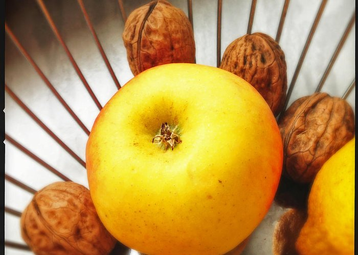 Apple Greeting Card featuring the photograph Food still life - yellow apple and brown walnuts - beautiful warm colors by Matthias Hauser