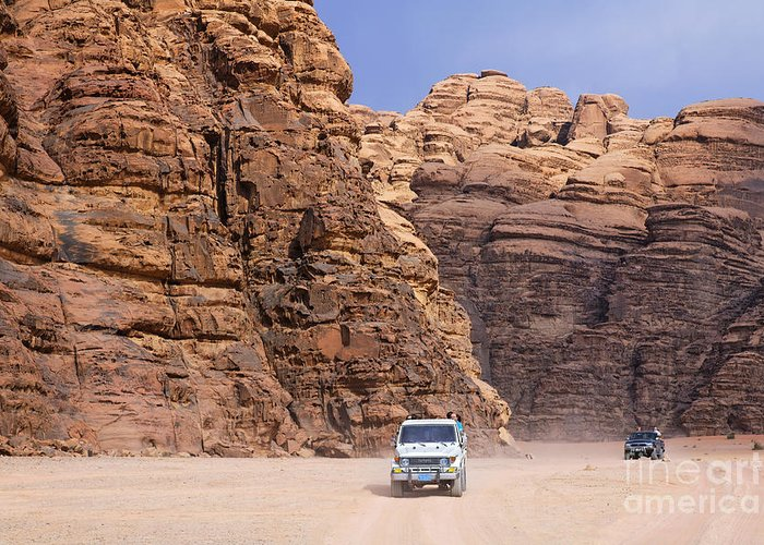 Jordan Greeting Card featuring the photograph Four Wheel Drive Vehicles At Wadi Rum Jordan by Robert Preston