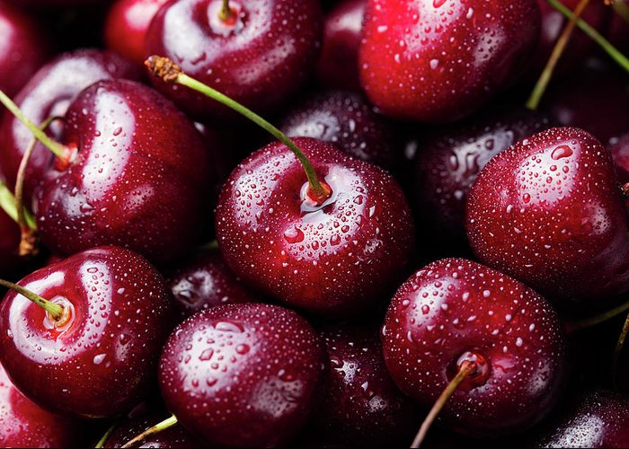 Cherry Greeting Card featuring the photograph Fresh Ripe Black Cherries Background by Anna Pustynnikova