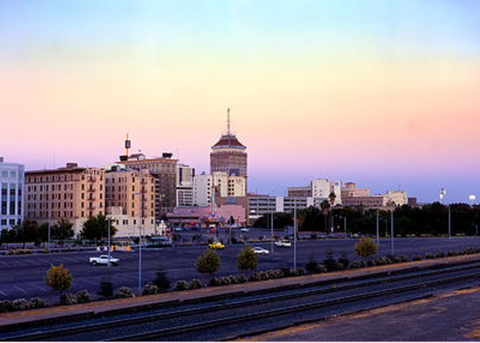 Fresno Skyline Greeting Card featuring the photograph Fresno Skyline Into The Evening by Wernher Krutein