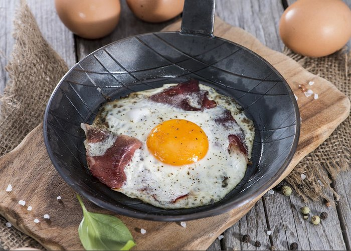 Fried Egg Greeting Card featuring the photograph Fried Egg In A Pan by Handmade Pictures