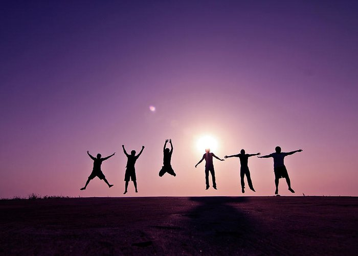 Human Arm Greeting Card featuring the photograph Friends Jumping Against Sunset by Kazi Sudipto Photography