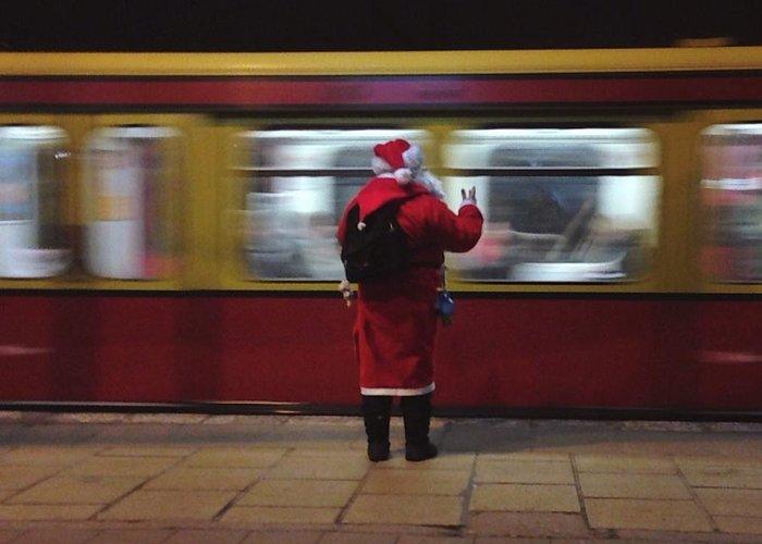 Passenger Train Greeting Card featuring the photograph Full Length Rear View Of Man In Santa by Monika Kanokova / Eyeem