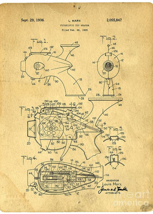Toy Greeting Card featuring the photograph Futuristic Toy Gun Weapon Patent by Edward Fielding