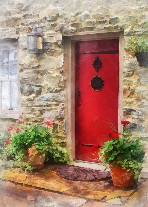 Door Greeting Card featuring the photograph Geraniums By Red Door by Susan Savad