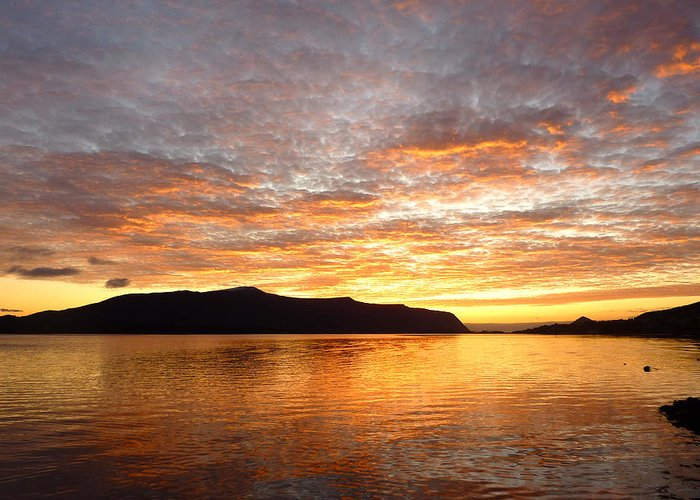 Sunset Greeting Card featuring the photograph Gilded Fjord While The Sun Set Over Norwegian Mountains by David Schoenheit
