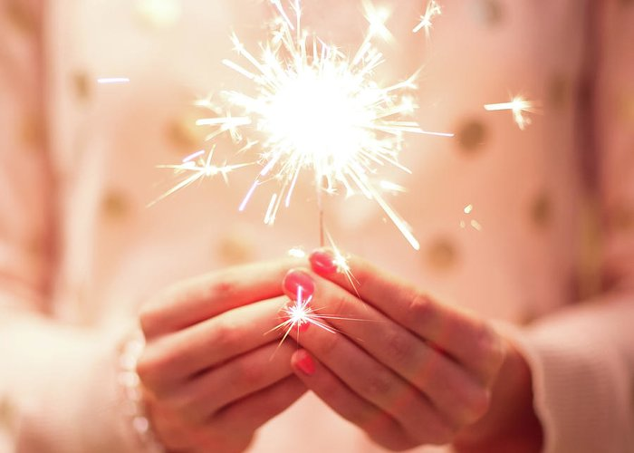 Firework Display Greeting Card featuring the photograph Girl Holding Small Sparkler by Sasha Bell