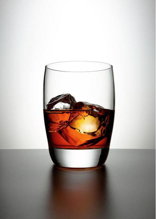 White Background Greeting Card featuring the photograph Glass With Brown Liquor And Ice Cubes by Chris Stein