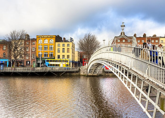 Dublin Greeting Card featuring the photograph Graceful Ha'penny Bridge Over River Liffey by Mark E Tisdale