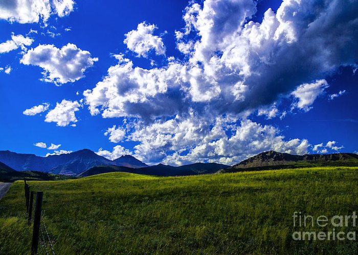 Swiring Clouds Green Fields Canada Rockies Landscapes Greeting Card featuring the photograph Green Field Of Clouds by Rick Bragan
