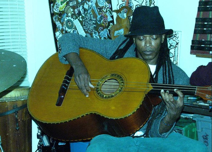 Guiltar Player Greeting Card featuring the photograph Gully Guitar And Black Hat by Cleaster Cotton