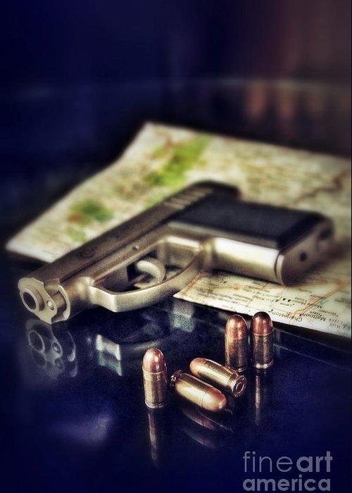 Gun Greeting Card featuring the photograph Gun With Bullets And Map by Jill Battaglia
