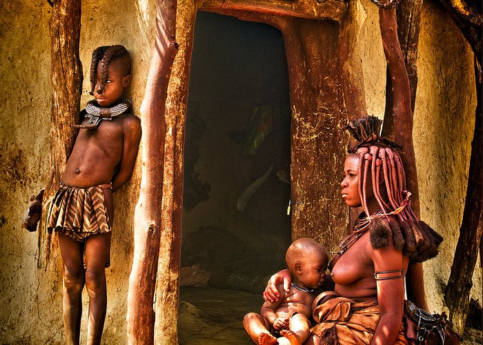 Africa Greeting Card featuring the photograph Himba Family By The Door Of Their Clay Hut by Paul W Sharpe Aka Wizard of Wonders