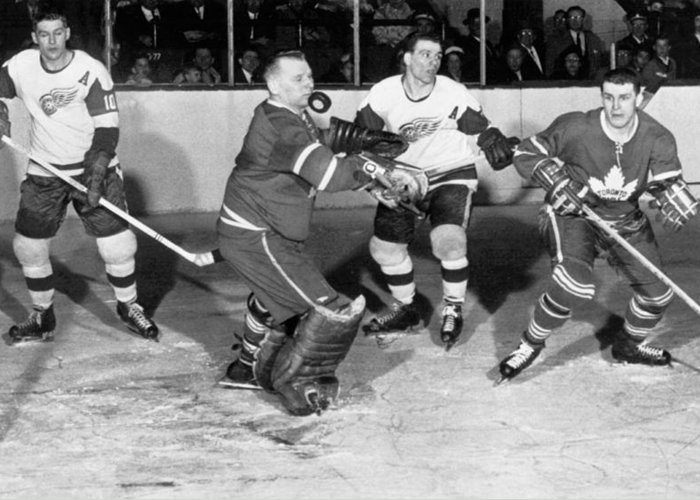 1950s Greeting Card featuring the photograph Hockey Goalie Chin Stops Puck by Underwood Archives