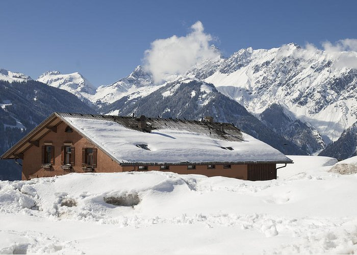 Winter Greeting Card featuring the photograph House In The Alps In Winter by Matthias Hauser