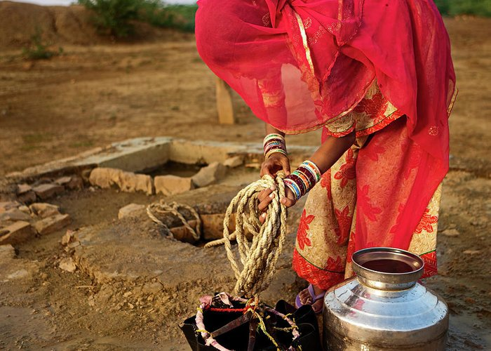Working Greeting Card featuring the photograph Indian Woman Getting Water From The by Hadynyah