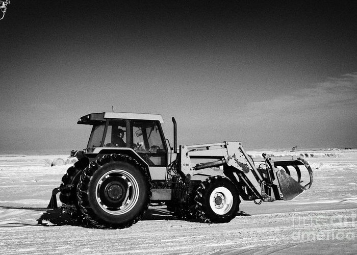 International Greeting Card featuring the photograph international 5140 tractor with front end loader on frozen field Forget Saskatchewan Canada by Joe Fox