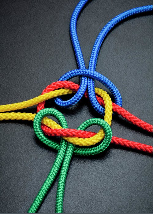 Teamwork Greeting Card featuring the photograph Intertwined Multicolored Ropes by Jorg Greuel