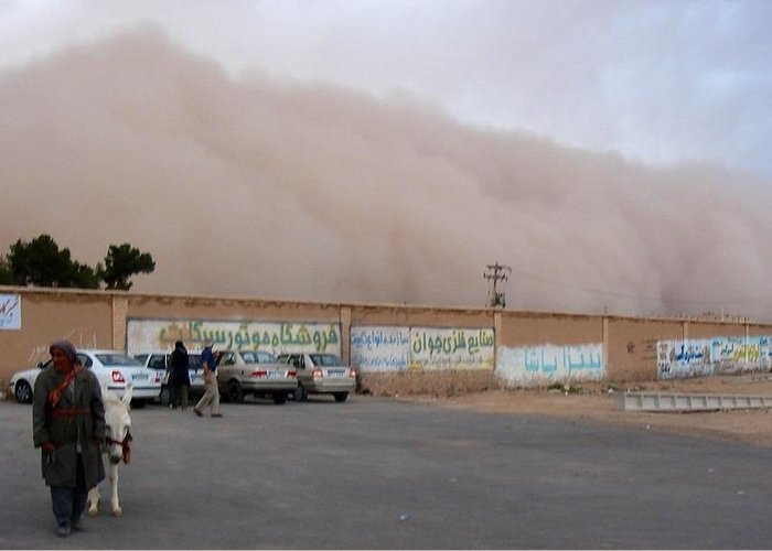 Sandstorm Greeting Card featuring the photograph Iran Sandstorm Yazd by Lois Ivancin Tavaf