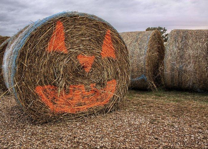 Halloween Greeting Card featuring the photograph Jack-o-lantern Hayroll by Jason Politte
