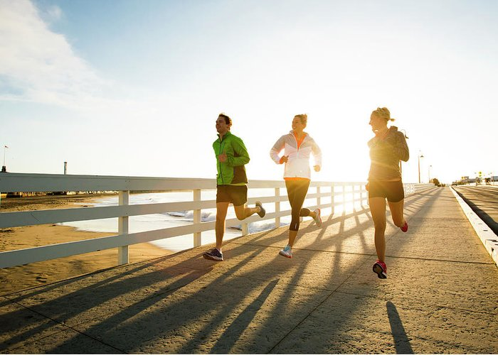 Young Men Greeting Card featuring the photograph Jogging Along The Coast by Jordan Siemens