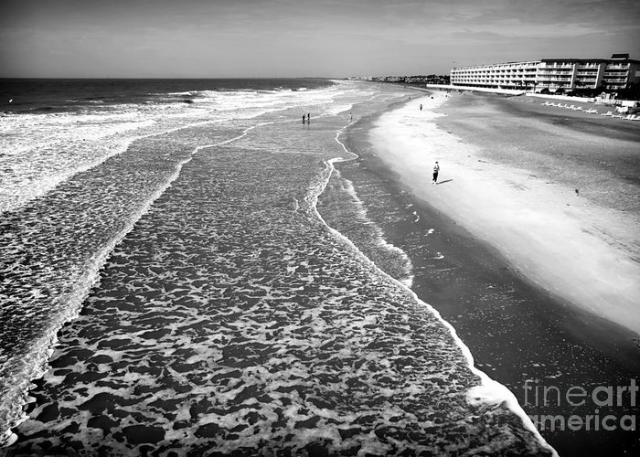 Jogging At Folly Beach Greeting Card featuring the photograph Jogging At Folly Beach by John Rizzuto