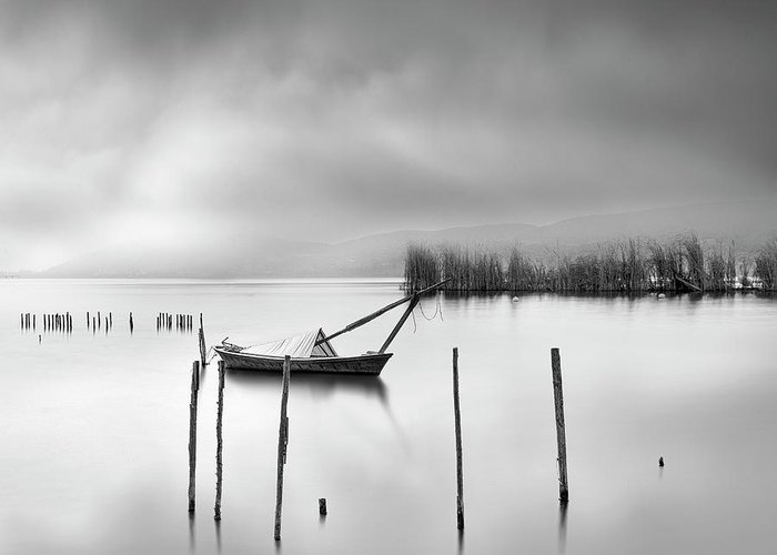 Seascape Greeting Card featuring the photograph Lake View With Poles And Boat by George Digalakis