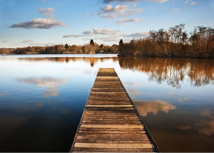 Pier Greeting Card featuring the photograph Landscape Of Fishing Jetty On Calm Lake At Sunset With Reflectio by Matthew Gibson