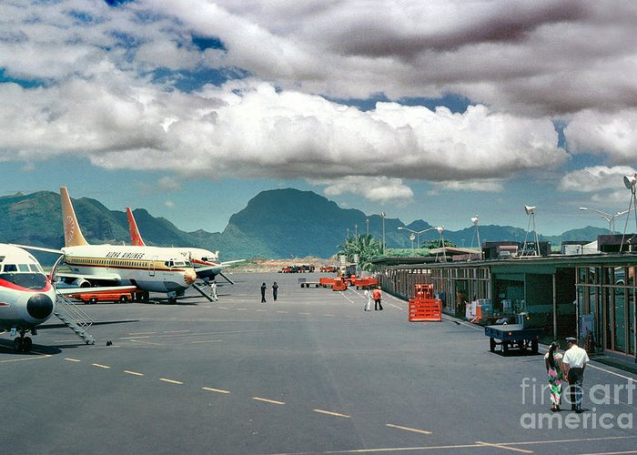 Lihue Airport Greeting Card featuring the photograph Lihue Airport With Cumulus Clouds In Kauai Hawaii by Wernher Krutein