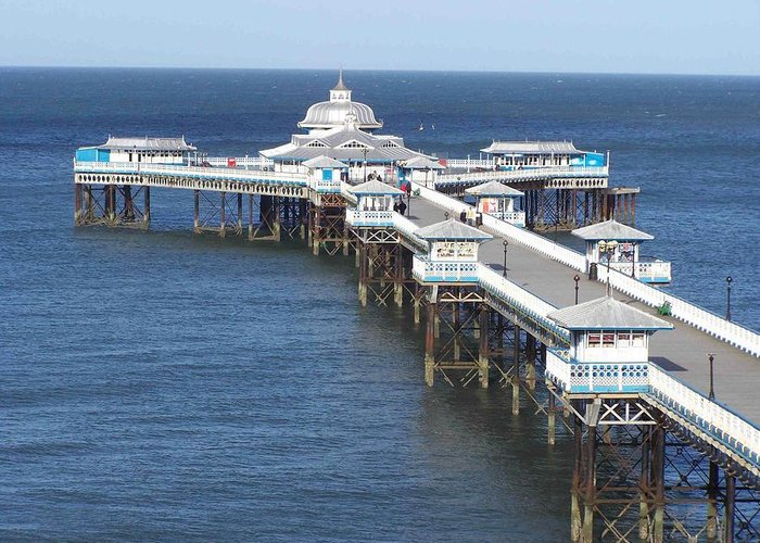 Piers Greeting Card featuring the photograph Llandudno Pier by Christopher Rowlands