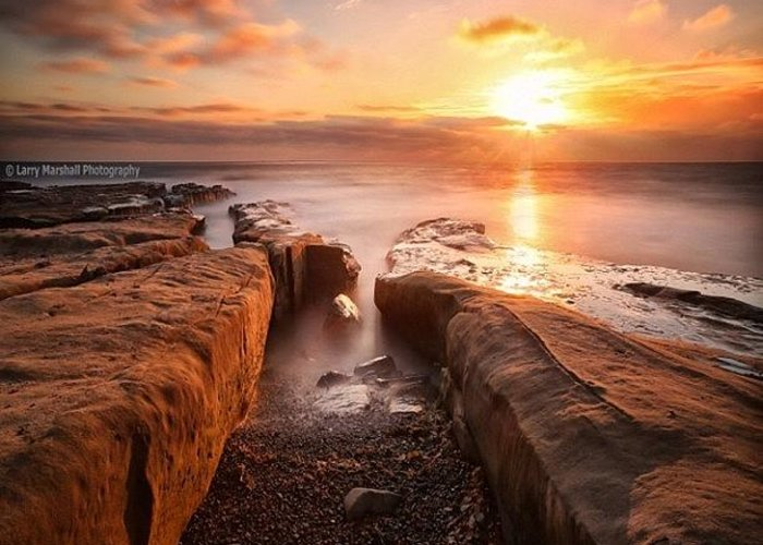 Greeting Card featuring the photograph Long Exposure Sunset At A Rocky Reef In by Larry Marshall