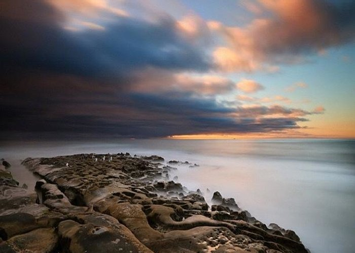 Greeting Card featuring the photograph Long Exposure Sunset Of An Incoming by Larry Marshall