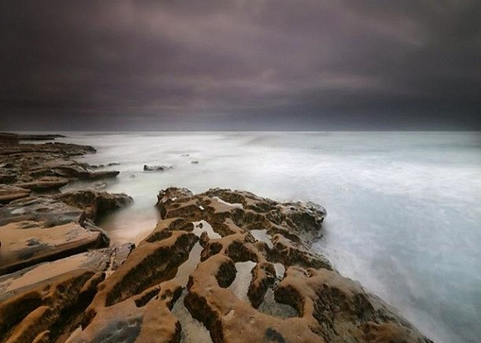 Greeting Card featuring the photograph Long Exposure Sunset On A Dark Stormy by Larry Marshall