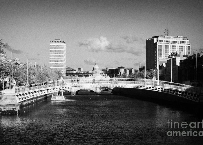 Dublin Greeting Card featuring the photograph Looking Down The Liffey Towards The Hapenny Ha Penny Bridge Over The River Liffey In Dublin by Joe Fox