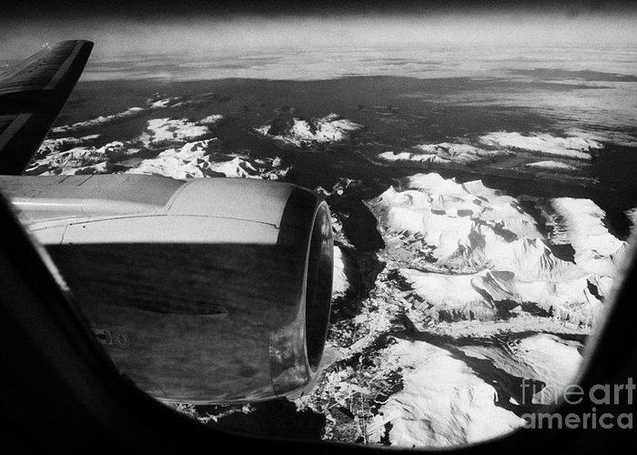 Looking Greeting Card featuring the photograph Looking Out Of Aircraft Window Over Engine And Snow Covered Fjords And Coastline Of Norway Europe by Joe Fox