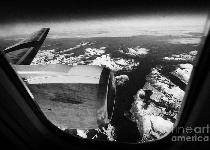 Looking Greeting Card featuring the photograph Looking Out Of Aircraft Window Over Snow Covered Fjords And Coastline Of Norway Europe by Joe Fox