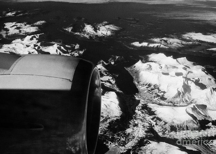 Looking Greeting Card featuring the photograph Looking Out Of Aircraft Window Past Engine And Over Snow Covered Fjords And Coastline Of Norway Euro by Joe Fox