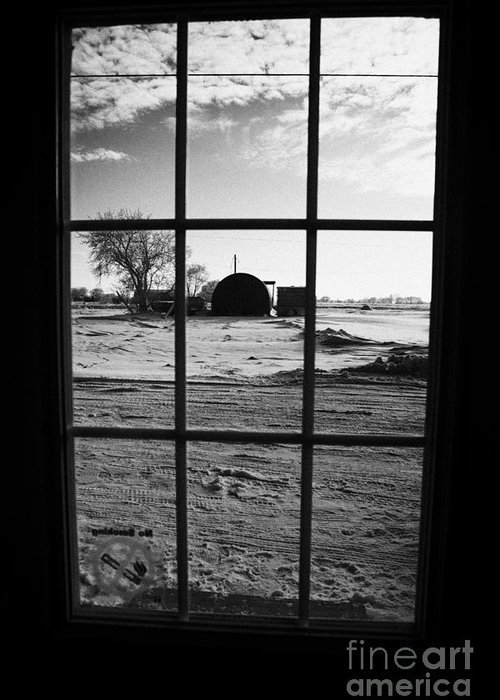 Looking Greeting Card featuring the photograph looking out through door window to snow covered scene in small rural village of Forget by Joe Fox
